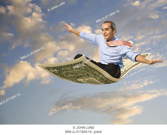 Businessman flying on a dollar bill