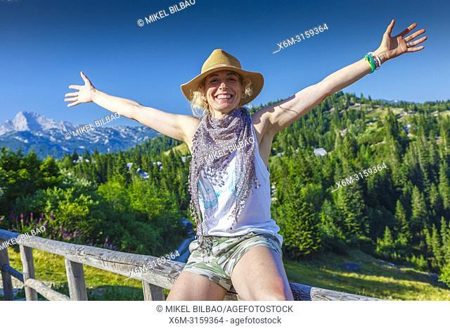 Mountains landscape in summer with woman. Velika Planina area. Upper Carniola region. Slovenia, Europe
