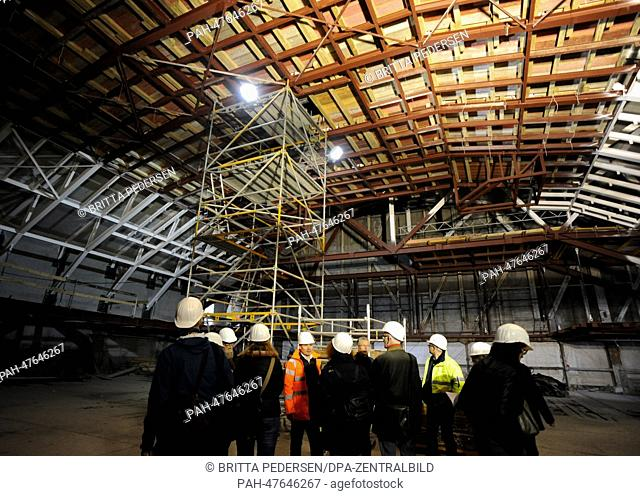 A group of visitors looks at the roof at the construction site of the State Opera Unter den Linden in Berlin, Germany, 04 April 2014