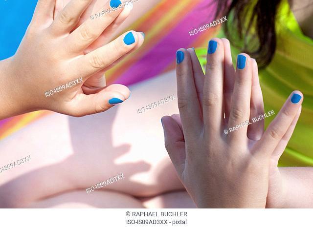 Friends touching hands