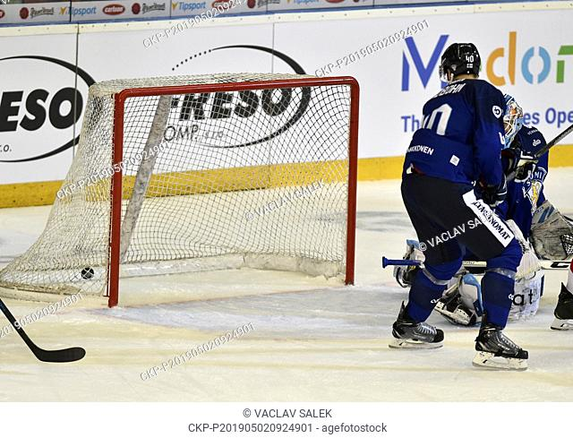 From left JUSSI OLKINUORA of Finland and Finnish Goalie PETTERI LINDBOHM receives goal during the Carlson Hockey Games tournament