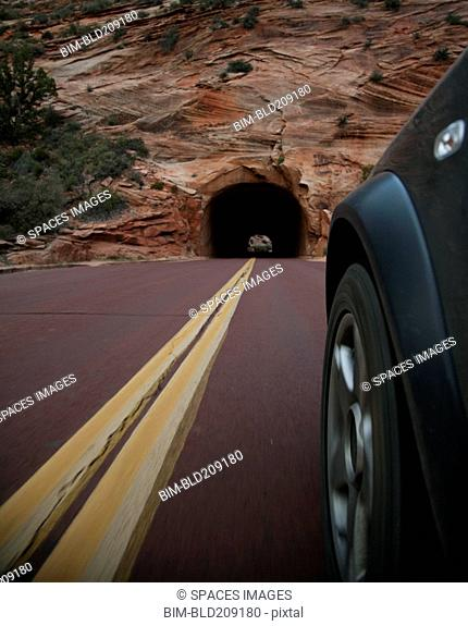 Car driving on rural road in Zion National Park, Utah, United States
