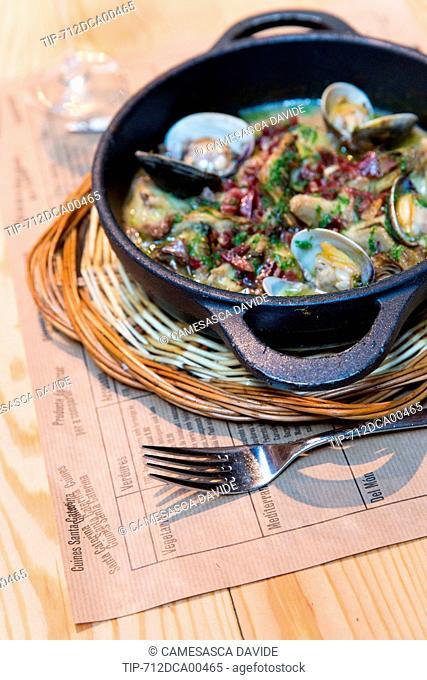 Spain, Catalonia, Barcelona, Santa Caterina market, Artichokes with ham and clams at Cuines Santa Caterina restaurant