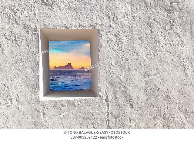 Balearic islands Es Vedra sunset view through whitewashed window
