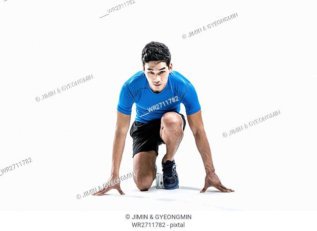 Male athlete sitting starting at front