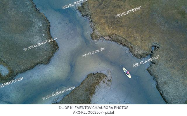 Aerial view of paddleboarder surfing in Scarborough Marsh, Maine, USA