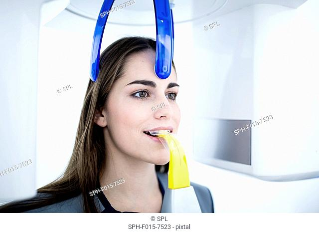 MODEL RELEASED. Young woman having x-ray in clinic