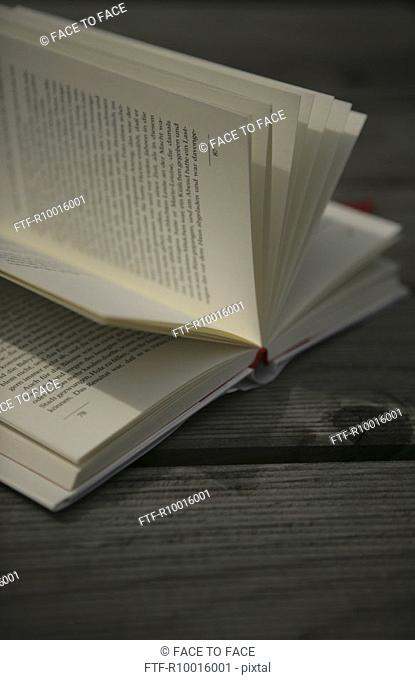 Close up of a novel placed on a wooden table