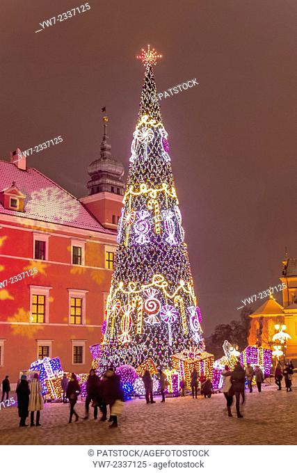 Christmas illumination of Castle Square, Royal Castle and Christmas tree in the Old Town of Warsaw, Poland