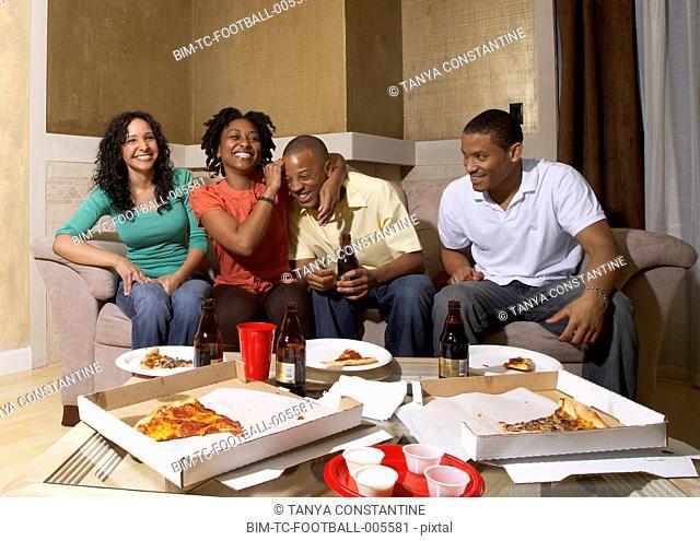 Multi-ethnic friends having pizza party
