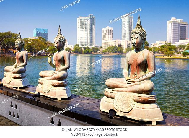 Sri Lanka - Capital City Colombo, Buddha Statues in Seema Malaka Temple on Beira Lake, 'World Trade Center' in the background , Sri Lanka, Asia