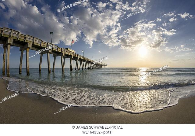 late afternoon sun over Gulf of Mexico and Venice Pier in Venice Florida