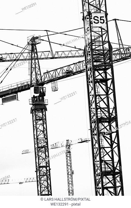 Building cranes on construction site in Stockholm, sweden