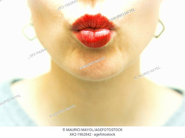 Close up of girl's red lips kiss