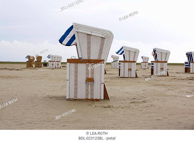 empty beach chairs on beach