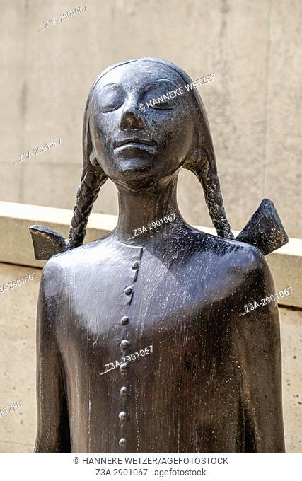 Sculpture of a schoolgirl with braids at the beach of Scheveningen, The Hague, The Netherlands, Europe