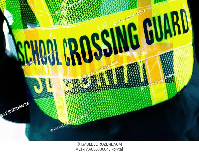 'School Crossing Guard' typography on security vest, montage
