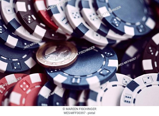 Gambling chips and 1 Euro coin, full frame