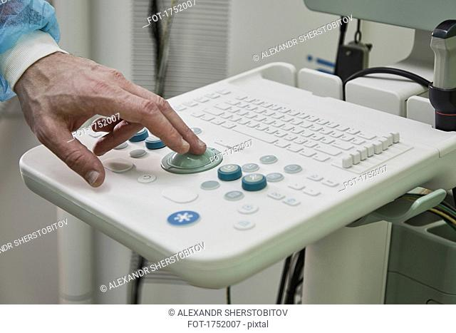 Cropped image of medical worker using ultrasound equipment