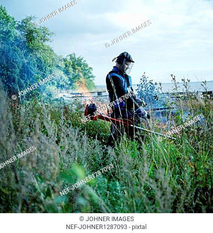 Man sawing in garden