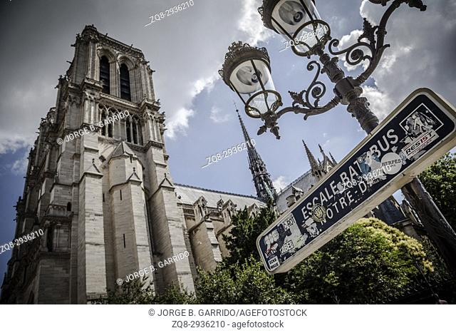 Notre Dame cathedral with puffy clouds, Paris, France