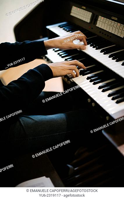 Hands play a keyboard