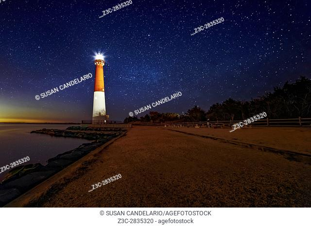 Barnegat Lighthouse Under The Stars - A beautiful star filled sky at. Barnegat Lighthouse State Park located on the northern tip of Long Beach Island in Ocean...
