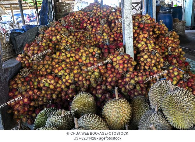 Lots of rambutans and durians for sale in Selakau small town, West Kalimantan, Indonesia