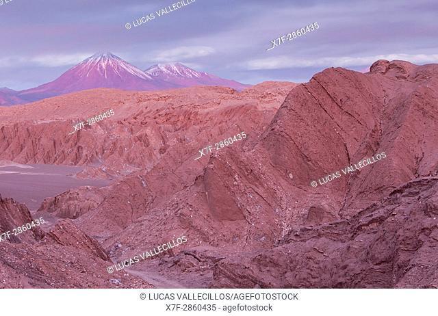 Valle de la Muerte (Valley of the Death), in background at left volcanoes Licancabur and Juriques, Atacama desert. Region de Antofagasta. Chile