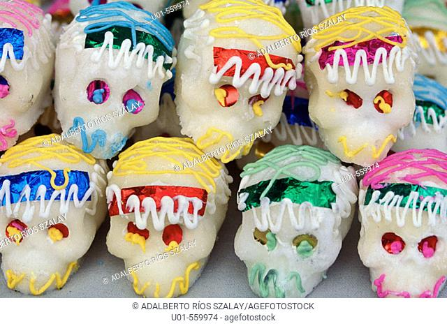 Sugar skulls. Mexican tradition in All Saint's Day, devoted to remembering the dead, is to offer sweet skulls with their names on. Mexico