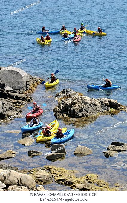Kayaks, narrow boat primarily designed to be manually propelled by means of a double-bladed paddle. S'Alguer cove area between the place of Fosca and Castell...