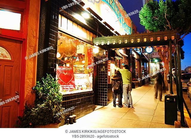 Patrons Enter the Stinking Rose, a Popular Restaurant in San Francisco's Italian North Beach Neighborhood