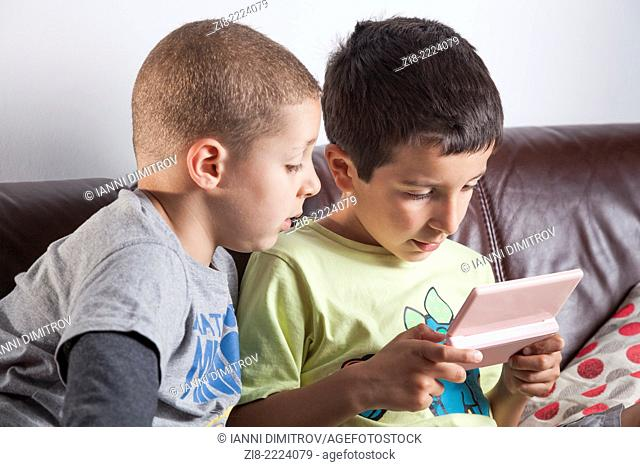 Boys playing computer game
