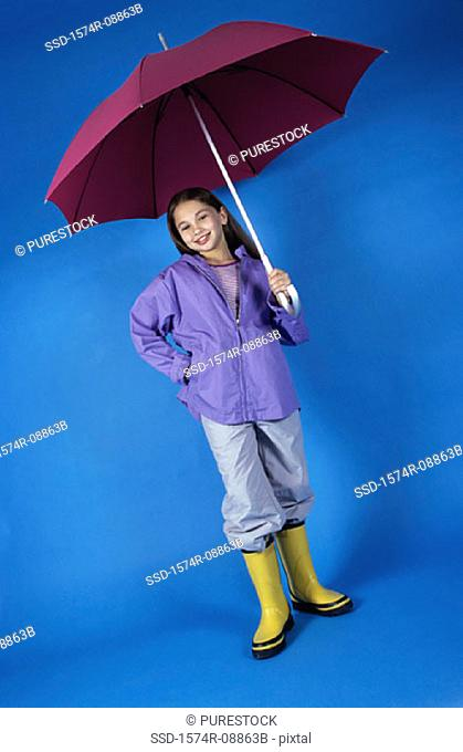 Portrait of a girl holding an umbrella