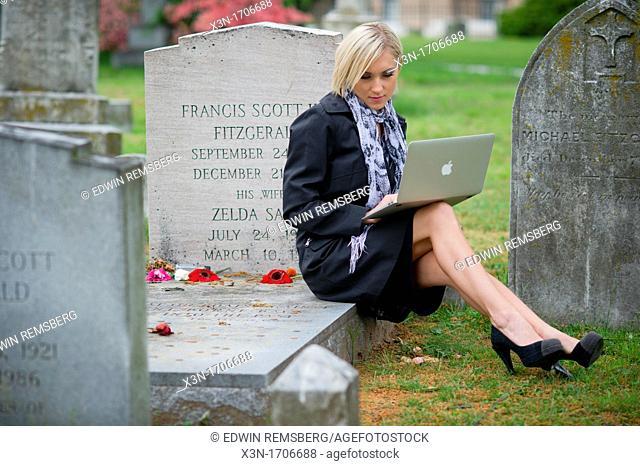 Blonde woman at F Scott Fitzgerald Gravesite, Rockville Maryland