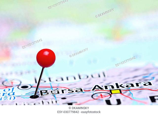 Photo of pinned Bursa on a map of Asia. May be used as illustration for traveling theme