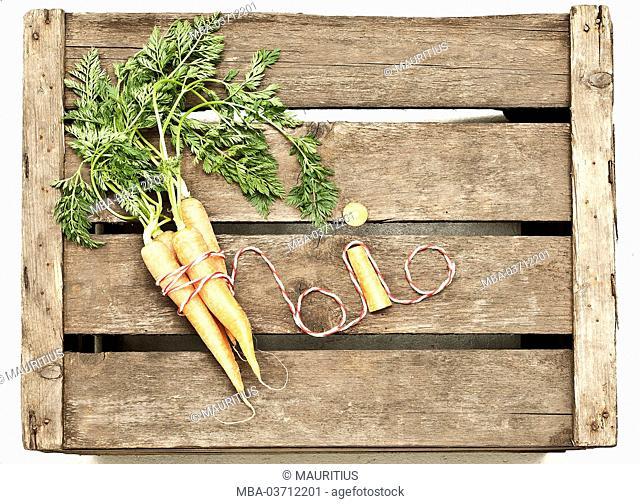 Wooden box, carrots, bio-product