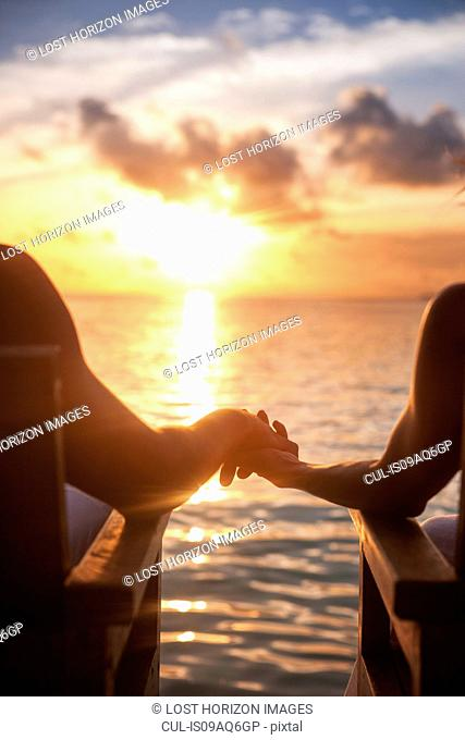 Couple holding hands on vacation