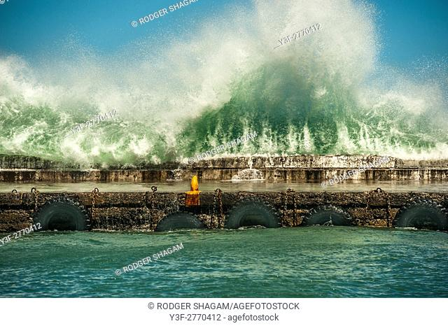 Spring tide during a Super moon phase at Kalk Bay Fishing Harbour. Cape Town, South Africa
