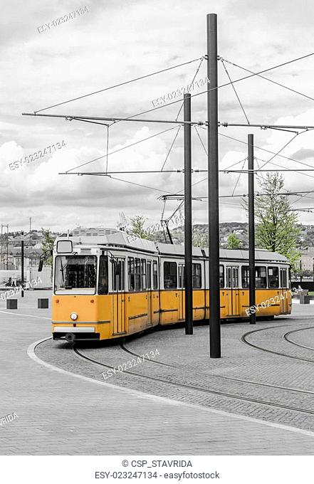 Yellow tram walking down