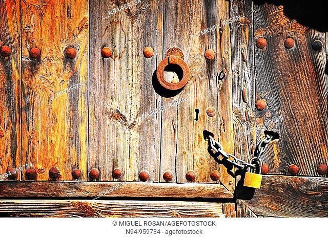 Old wooden door with knocker and lock