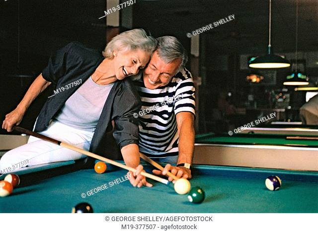 couple shooting pool (billards)