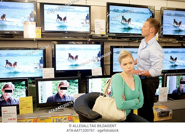 Couple is looking for a flat screen, she is annoyed