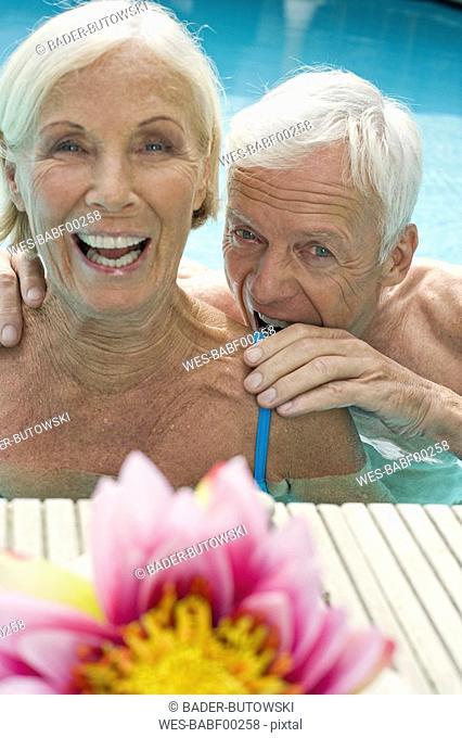 Germany, Senior couple in pool ,having fun close-up