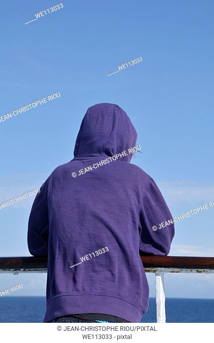 Back view of person looking at sea