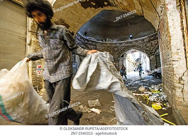 Worker carries sacks with garbage after closing Grand bazaar in Tehran, an estimated 50,000 tons of trash is produced in Iran every day, especially on bazaars