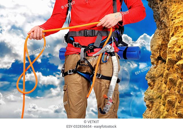 hiker holding rope on mountain background