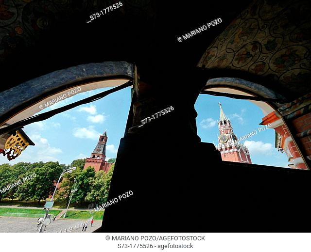 Kremlin walls and Spasskaya Tower view from inside Saint Basil Cathedral, Moscow, Russian Federation