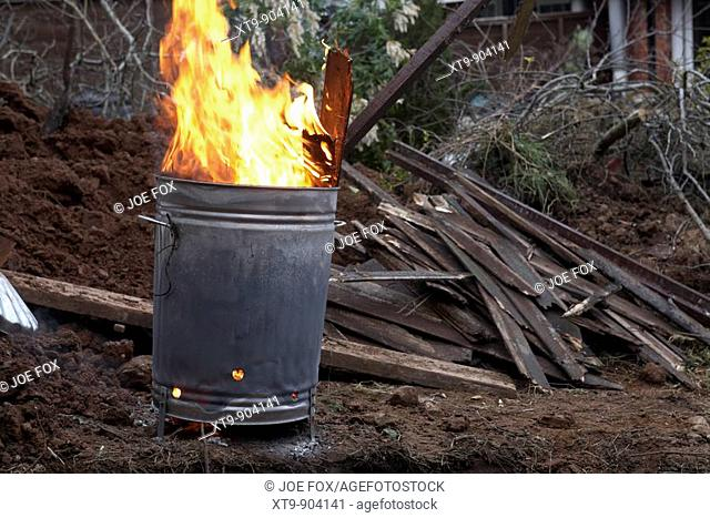 garden incinerator burning household and garden wooden waste and branches