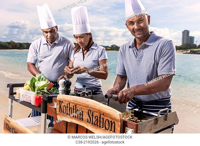 Asian catering chefs at the beach cooking with a Koththu station. Gold Coast, Queensland, Australia